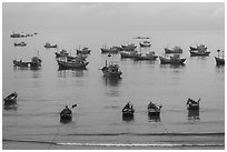 Fishing boats moored at the fishing beach. Mui Ne, Vietnam (black and white)