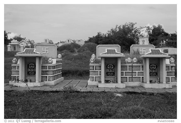 Mix of Buddhist and Christian tombs. Mui Ne, Vietnam (black and white)