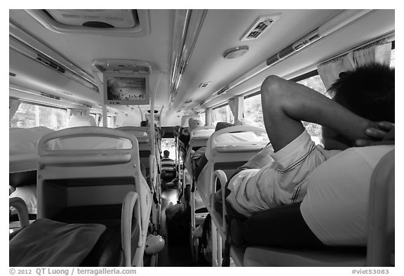 Inside bus with reclining seats for sleeping. Vietnam (black and white)