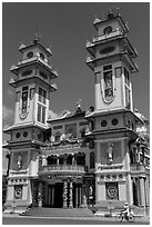 Great Temple of Cao Dai facade. Tay Ninh, Vietnam (black and white)