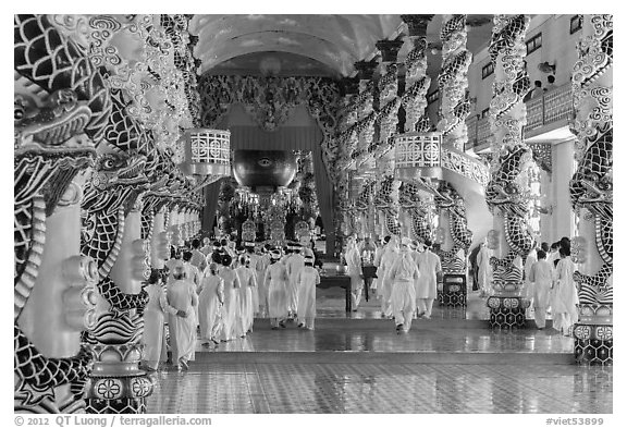 Cao Dai followers during a service inside Holy See. Tay Ninh, Vietnam (black and white)