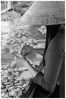Woman wearing conical hat wrapping coconut candy, Phoenix Island. My Tho, Vietnam ( black and white)