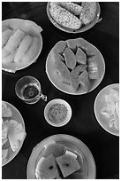 Fresh fruit quartered and served on table, Phoenix Island. My Tho, Vietnam ( black and white)