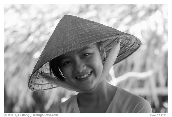 Portrait of girl with conical hat, Phoenix Island. My Tho, Vietnam (black and white)