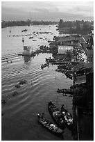Boats and riverfront from above at dawn. Can Tho, Vietnam (black and white)