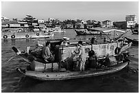 Seller and buyer talking across boats, Cai Rang floating market. Can Tho, Vietnam ( black and white)