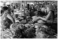 Buying and selling vegetable inside covered market, Cai Rang. Can Tho, Vietnam (black and white)