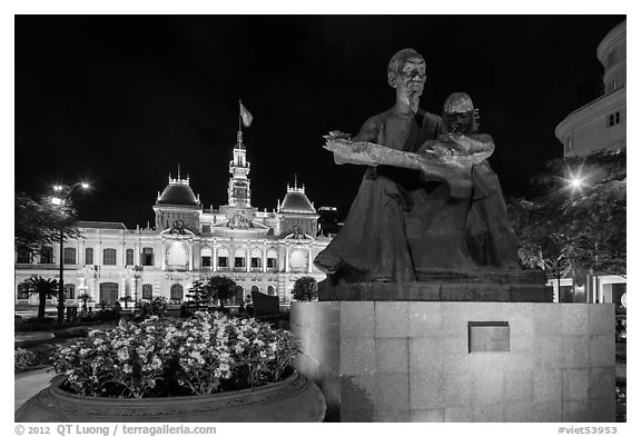 Ho Chi Minh as teacher bronze by Diep Minh Chau and City Hall by night. Ho Chi Minh City, Vietnam (black and white)