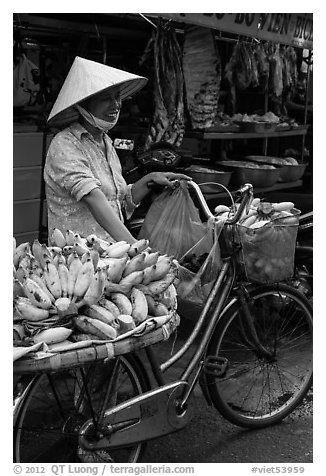 Woman selling bananas from bicycle. Ho Chi Minh City, Vietnam (black and white)