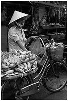Woman selling bananas from bicycle. Ho Chi Minh City, Vietnam ( black and white)