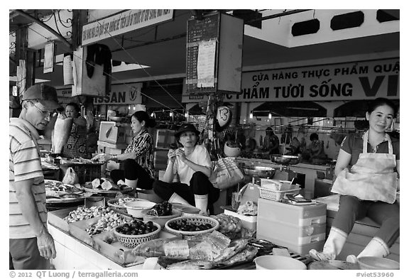 Vendors in Ben Thanh market. Ho Chi Minh City, Vietnam (black and white)