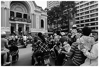 Families gather on moterbikes to watch musical performance. Ho Chi Minh City, Vietnam (black and white)