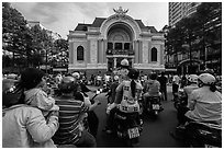 Families gather on motorbikes to watch performance in front of opera house. Ho Chi Minh City, Vietnam ( black and white)