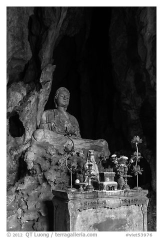 Altar and Buddha statue in grotto. Da Nang, Vietnam (black and white)