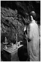Buddha statue in narrow cave, Marble Mountains. Da Nang, Vietnam ( black and white)