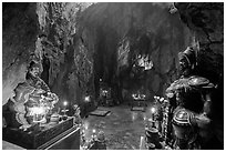 Guardian deities at the entrance of Huyen Khong cave. Da Nang, Vietnam (black and white)