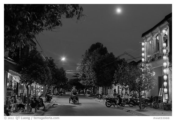 Street at dusk with moon and lanterns. Hoi An, Vietnam