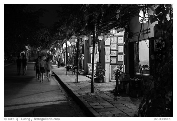 Street lined with art galleries by night. Hoi An, Vietnam (black and white)