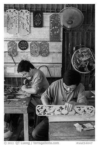 Wood carving workshop. Hoi An, Vietnam (black and white)