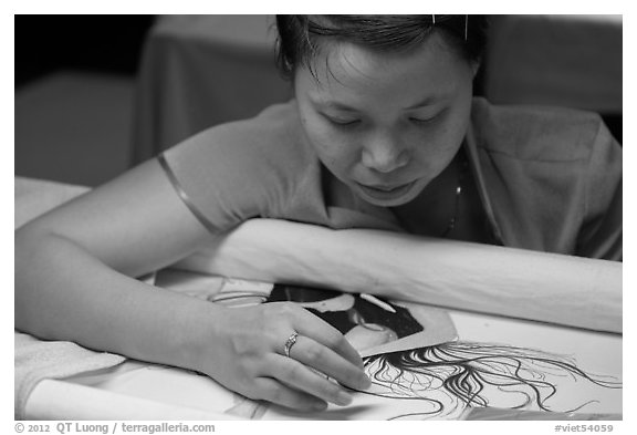 Woman working on a silk embroidery piece. Hoi An, Vietnam (black and white)