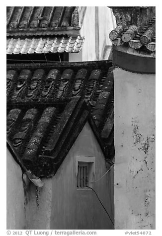 Roofs and blue walls detail. Hoi An, Vietnam (black and white)
