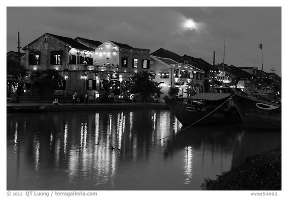 Moonrise over houses and river. Hoi An, Vietnam (black and white)