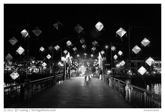 Cam Nam bridge with lighted lanterns at night. Hoi An, Vietnam (black and white)