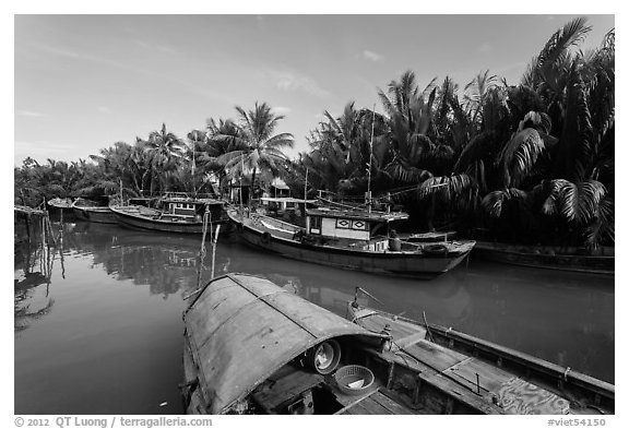 River channel and boats near Cam Kim Village. Hoi An, Vietnam (black and white)