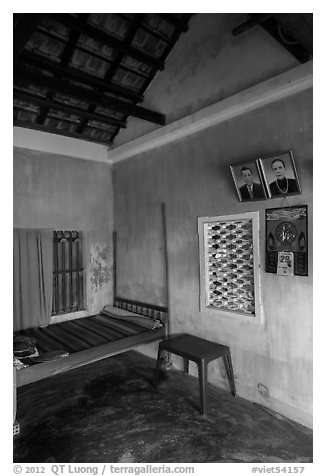 Village home with ancester pictures. Hoi An, Vietnam (black and white)