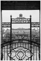 Palace of Supreme Peace viewed from gate in the rain. Hue, Vietnam (black and white)