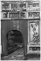 Palace gate with ceramic decorations, citadel. Hue, Vietnam (black and white)