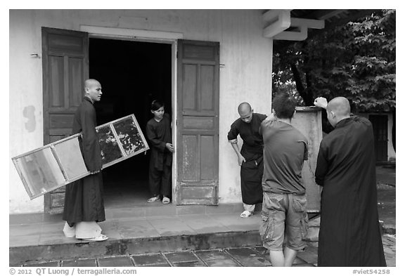 Monks carrying furniture, Thien Mu pagoda. Hue, Vietnam (black and white)