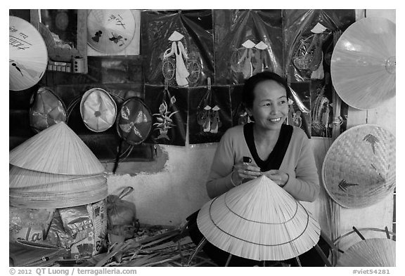 Woman in hat-making workshop. Hue, Vietnam (black and white)