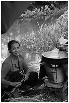 Woman cooking canalside, Thanh Toan. Hue, Vietnam (black and white)