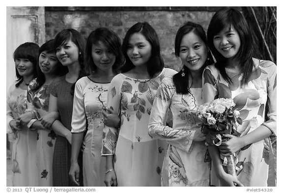 Row of women in Ao Dai, Temple of the Litterature. Hanoi, Vietnam (black and white)