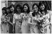 Row of women in Ao Dai, Temple of the Litterature. Hanoi, Vietnam ( black and white)