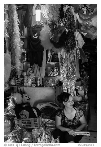 Store selling party costumes and decorations, old quarter. Hanoi, Vietnam (black and white)