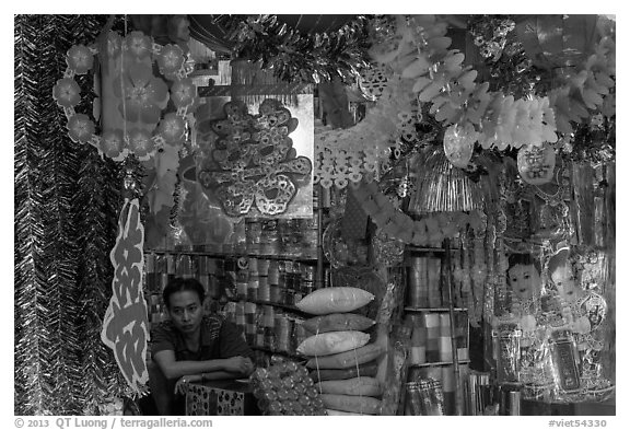 Store selling traditional party decorations, old quarter. Hanoi, Vietnam (black and white)