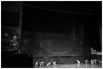 Musicians and water puppets during performance, Thang Long Theatre. Hanoi, Vietnam (black and white)