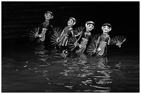 Water puppets (4 characters with fans), Thang Long Theatre. Hanoi, Vietnam ( black and white)