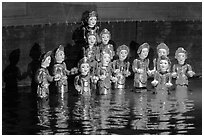 Water puppets (14 characters with lotus), Thang Long Theatre. Hanoi, Vietnam ( black and white)