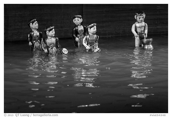 Water puppets (5 characters with musical instruments), Thang Long Theatre. Hanoi, Vietnam (black and white)