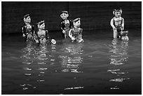 Water puppets (5 characters with musical instruments), Thang Long Theatre. Hanoi, Vietnam ( black and white)