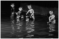 Water puppets (4 characters with musical instruments), Thang Long Theatre. Hanoi, Vietnam ( black and white)