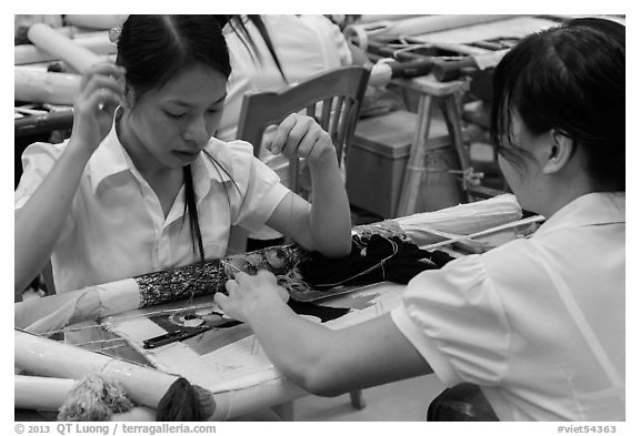 Women in silk embroidery factory. Vietnam (black and white)
