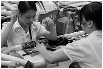 Women in silk embroidery factory. Vietnam ( black and white)