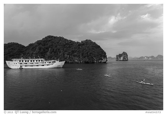 Tour boat and sea kayaks. Halong Bay, Vietnam (black and white)