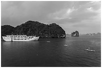 Tour boat and sea kayaks. Halong Bay, Vietnam ( black and white)
