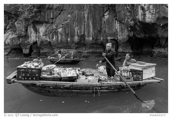 Grocer on rowboat. Halong Bay, Vietnam (black and white)
