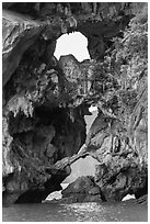Openings through rocks. Halong Bay, Vietnam ( black and white)